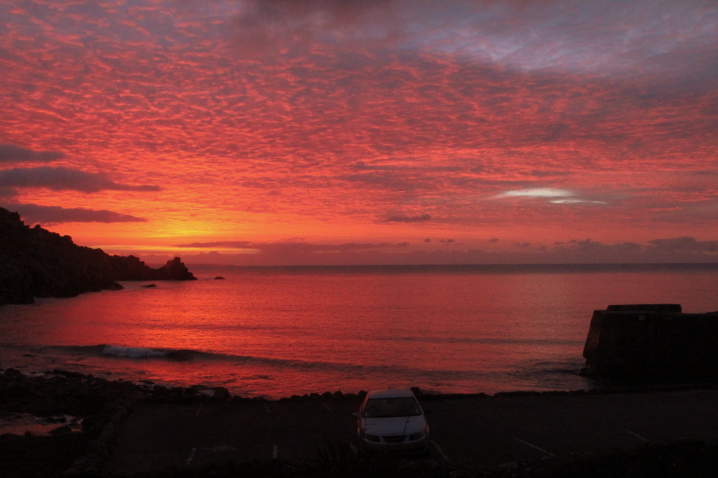 Sunrise from the bedroom window at Cove House self catering holiday home in west Cornwall.