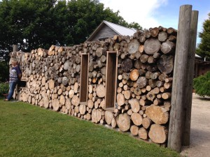 Log wall, The Potager.
