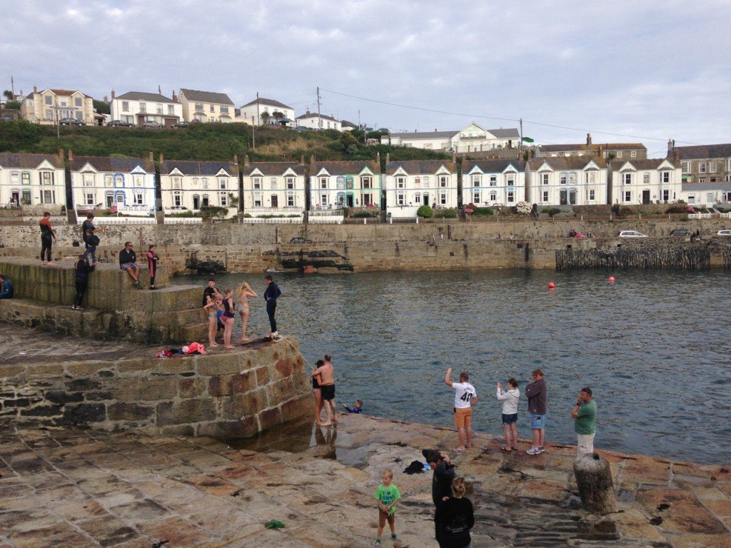 Divers on the harbour walls.