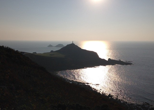 Cape Cornwall with an early setting sun.