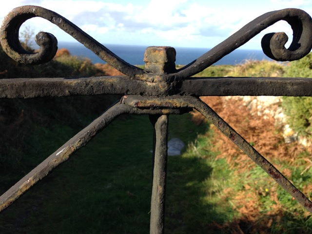 A gate. The sea.