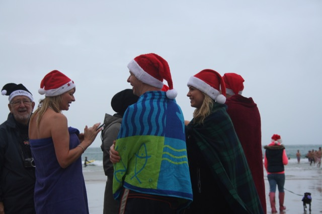 Santa Family at Sennen Christmas swim. www.thecornishway.co.uk