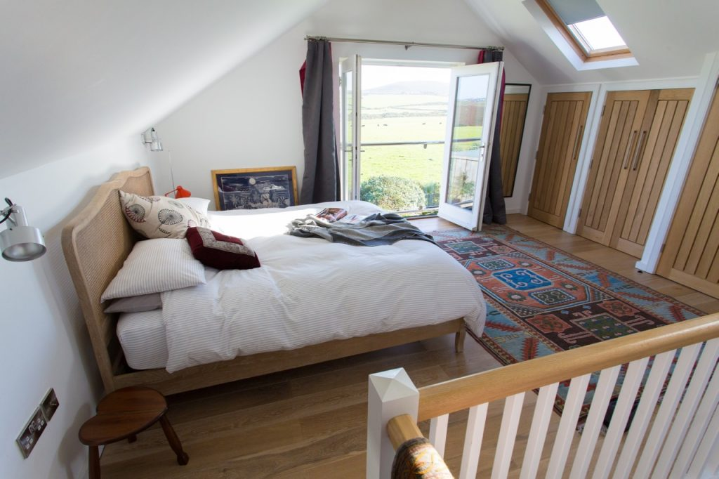 The wonderful bed with views of Chapel Carn Brea.
