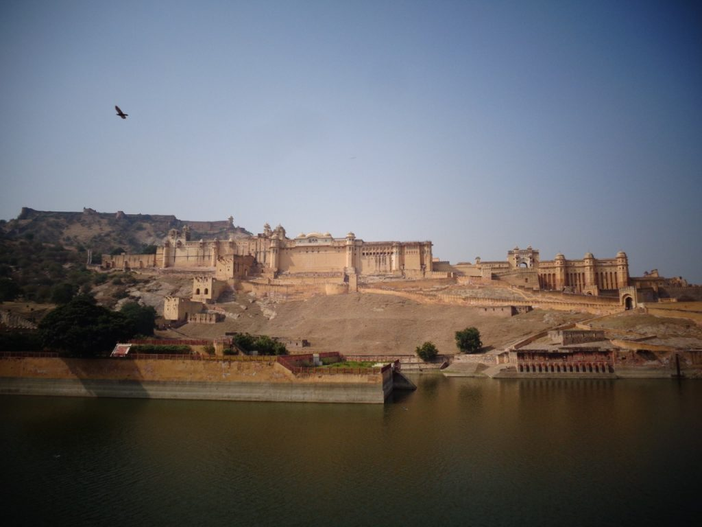 The Amer / Amber Fort from across one of its reservoirs.